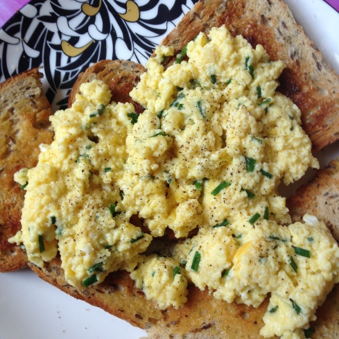 Scrambled egg on toast with cheese