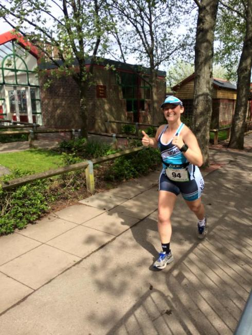 Tamsyn running during May Day Tri
