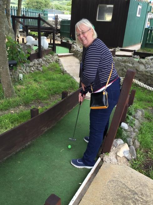 Sandra playing crazy golf