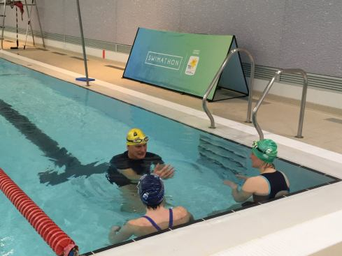 Duncan Goodhew in the pool explaining drills