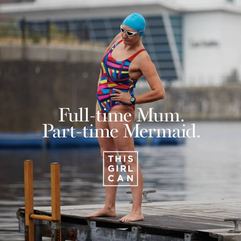 This Girl Can advert showing a woman standing on a dock wearing a swimming costume. The slogan says 'Full-time Mum. Part-time Mermaid.'